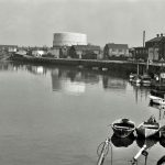 Workington old harbour looking east to St. Michael's church and gas holder. 1960s.