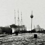 Workington harbour. Williamson's shipyard with 3-masted sailing ship and another on stocks. Navigation beacon. 1900s?