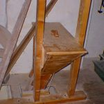 Flour sieve feed chute (on upper floor). The rope at the front is the on/off switch for the water wheel