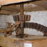 Central stone drive shaft with pit wheel behind