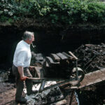 Larry Walling with peat barrow (149-048)